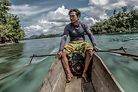 35 year old Marjono Lessing travels to an offshore reef on his boat. Traditionally, Bajau boats were powered by paddles only, but the introduction of motors have opened up new opportunities.