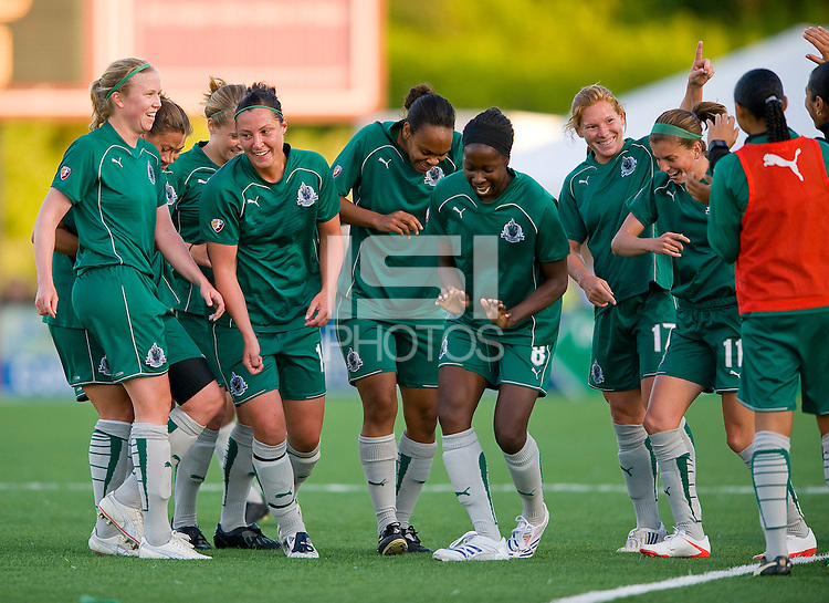 St Louis Athletica midfielder Lori Chalupny (17) and teammates celebrate after scoring on her own corner kick against FC Gold Pride during a WPS match at Korte Stadium, in st. Louis, MO, May 9 2009.
