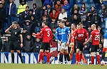 16.03.2019 Rangers v Kilmarnock: Ref Greg Aitken listens to a voice in his ear as he books Connor Goldson