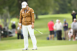 Inbee Park reacts after missing her putt on the 12th green at the LPGA Championship 2014 Sponsored By Wegmans at Monroe Golf Club in Pittsford, New York on August 13, 2014