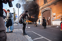 Press photographers reporting during the manifestation of the Italian Indignados that turned into a violent guerrilla. Rome, Italy. Oct. 15, 2011. (Photo by Riccardo Budini / UnFrame)