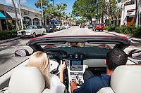 Sandra Kaseta and Richie Rodriguez take a spin down Fifth Avenue South in a Maserati for sale at Luxury Imports of Naples, 900 Tamiami Trail, Naples, Florida, USA, July 20, 2012. Photo by Debi Pittman Wilkey, CoastalLife.com.
