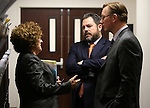 Nevada Sens., from left, Debbie Smith, D-Sparks, Michael Roberson, R-Henderson, and Ben Kieckhefer, R-Reno, talk during the final hours of the 77th Legislative session at the Legislative Building in Carson City, Nev., on Monday, June 3, 2013. (AP Photo/Cathleen Allison)
