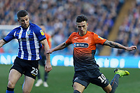 Bersant Celina of Swansea City (R) and Sam Hutchinson of Sheffield Wednesday (L) in action during the Sky Bet Championship match between Sheffield Wednesday and Swansea City at Hillsborough Stadium, Sheffield, England, UK. Saturday 23 February 2019