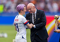 LYON,  - JULY 7: Megan Rapinoe #15 receives her trophy from Gianni Infantino during a game between Netherlands and USWNT at Stade de Lyon on July 7, 2019 in Lyon, France.