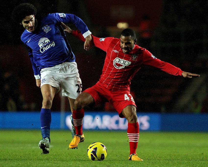 Southampton's Jason Puncheon holds off Everton's Marouane Fellaini...- Credit - CameraSport - James Marsh - ..Football - Barclays Premiership - Southampton v Everton - Monday 21st January 2013 - St Mary's - Southampton..
