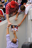 Recently retired member of the Los Angeles Galaxy, Clit Mathis high fives a fan while giving out autographs.  The Los Angeles Galaxy defeated the New York Red Bulls 1-0 during a Major League Soccer (MLS) match at Red Bull Arena in Harrison, NJ, on August 14, 2010.