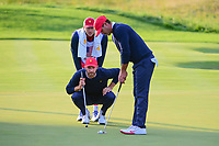 Dustin Johnson (USA) lines up his putt on 16 during round 3 Four-Ball of the 2017 President's Cup, Liberty National Golf Club, Jersey City, New Jersey, USA. 9/30/2017.<br /> Picture: Golffile | Ken Murray<br /> <br /> All photo usage must carry mandatory copyright credit (&copy; Golffile | Ken Murray)