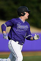 Designated hitter Jason Costa (9) of the Furman Paladins runs out a batted ball in game two of a doubleheader against the Harvard Crimson on Friday, March 16, 2018, at Latham Baseball Stadium on the Furman University campus in Greenville, South Carolina. Furman won, 7-6. (Tom Priddy/Four Seam Images)