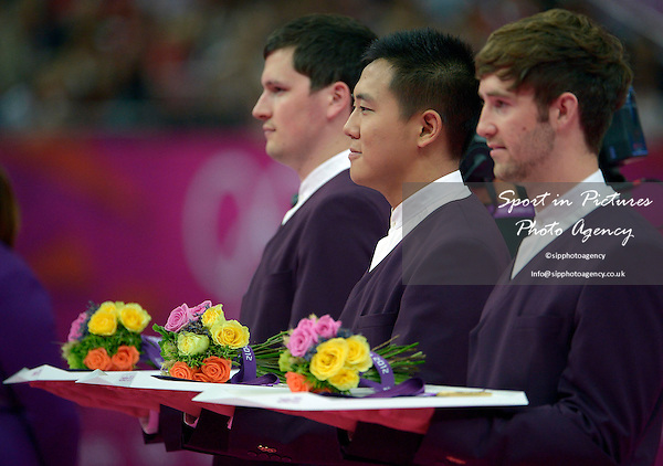 The medals and flowers. Trampoline - PHOTO: Mandatory by-line: Garry Bowden/SIP/Pinnacle - Photo Agency UK Tel: +44(0)1363 881025 - Mobile:0797 1270 681 - VAT Reg No: 768 6958 48 - 04/08/2012 - 2012 Olympics - North Greenwich Arena, London, England
