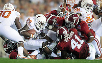 Jan 7, 2010; Pasadena, CA, USA; Texas Longhorns tight end Foster Vimont (84) is tackled by the Alabama Crimson Tide defense during the second quarter of the 2010 BCS national championship game at the Rose Bowl.  Mandatory Credit: Mark J. Rebilas-