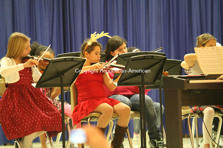 TORRINGTON, CT - 6 December, 2011 - 120611MO02 - The Forbes Elementary School orchestra performed a holiday concert Tuesday, drawing a packed house. Pictured here are, front row, from left, Sage Lavoie and Mileahna Videtto-Kittle (wearing antlers). Jim Moore Republican-American.