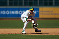 Baylor Bears third baseman Esteban Cardoza-Oquendo (52) fields a ground ball during the game against the Missouri Tigers in game one of the 2020 Shriners Hospitals for Children College Classic at Minute Maid Park on February 28, 2020 in Houston, Texas. The Bears defeated the Tigers 4-2. (Brian Westerholt/Four Seam Images)