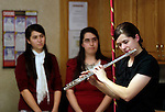 Waterbury, CT- 01 December 2016-120116CM02- Kathryn Bennett of Cheshire plays the flute during a Christmas concert at the Middlebury Convalescent Home on Friday.  The Bennett family entertained the residents and staff at the home by playing classic tunes using various instruments. Also performing in the concert were sisters, Julianna, back left and Lydia.    Christopher Massa Republican-American