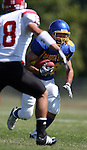MADISON, SD - AUGUST 30: Tanner Goforth of Dakota State University looks upfield as Ryan Parks of Bacone College defends in the second quarter of their game Saturday afternoon at Trojan Field in Madison. (photo by Dave Eggen/Inertia)