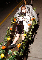 Celeste Martino, 9, gets pulled in a coffin in the All Souls' Procession on North Fourth Avenue Sunday night. About 3000 people took park in the procession.