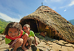 Curious kids peer into lens in fromt of tradtional home, Wae REbo, Flores.