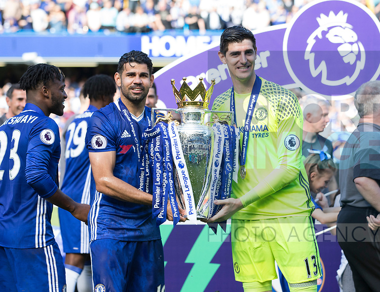 Chelsea's Diego Costa and Thibaut Courtois celebrate with the trophy during the Premier League match at Stamford Bridge Stadium, London. Picture date: May 18th, 2017. Pic credit should read: David Klein/Sportimage