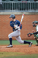 Dan Lawrence (38) of the Akron Zips follows through on his swing against the Charlotte 49ers at Hayes Stadium on February 22, 2015 in Charlotte, North Carolina.  The Zips defeated the 49ers 5-4.  (Brian Westerholt/Four Seam Images)