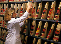 Medical records staff pulling a patient record.