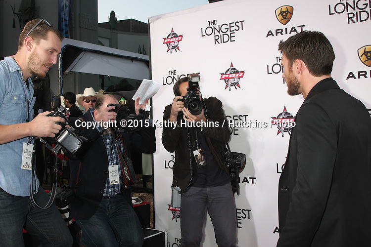 """LOS ANGELES - FEB 6:  Photographers, Scott Eastwood at the """"The Longest Ride"""" Los Angeles Premiere at the TCL Chinese Theater on April 6, 2015 in Los Angeles, CA"""