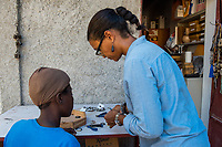 Haiti, Port-au-Prince, Artisan business, Atellier Calla , founded by Christelle Chignard Paul. Original handmade jewelry made from cow horn. Christelle working in her shop. (MR)