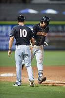 Jupiter Hammerheads shortstop Joe Dunand (3) is congratulated by manager Kevin Randel (10) as he rounds third base after hitting a ninth inning home run during a game against the Clearwater Threshers on April 9, 2018 at Spectrum Field in Clearwater, Florida.  Jupiter defeated Clearwater 9-4.  (Mike Janes/Four Seam Images)