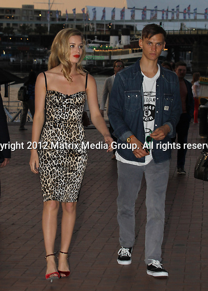 15 NOVEMBER 2012 SYDNEY AUSTRALIA ..NON EXCLUSIVE ..Georgia May Jagger pictured as Ambassador for Sunglass Hut - attending an event / product promo at Cockle Bay Wharf. Georgia's boyfriend Josh McLellan was close by her side with the couple leaving the even hand in hand...*No internet without clearance*.MUST CALL PRIOR TO USE ..+61 2 9211-1088.Matrix Media Group.Note: All editorial images subject to the following: For editorial use only. Additional clearance required for commercial, wireless, internet or promotional use.Images may not be altered or modified. Matrix Media Group makes no representations or warranties regarding names, trademarks or logos appearing in the images.