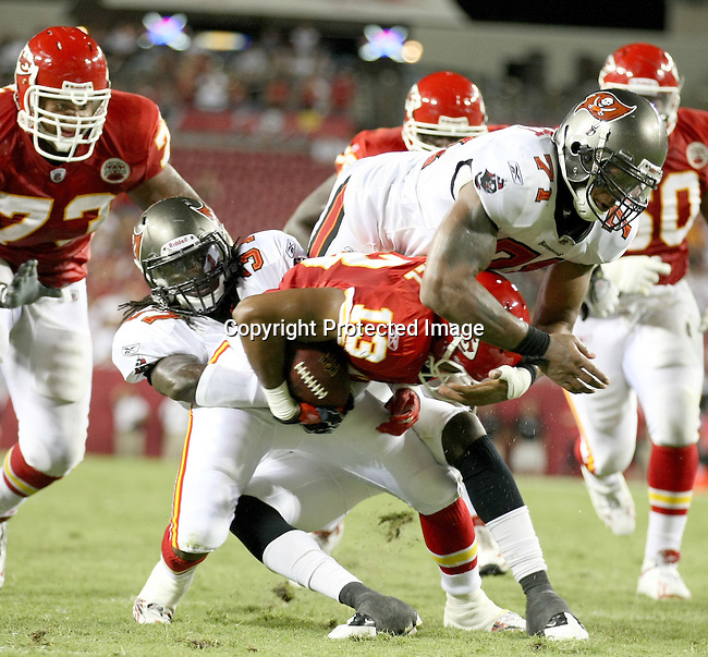 Tampa Bay Buccaneer's safety Vince Anderson and defensive lineman Michael Bennett combine to keep Kansas City Chief's wide receiver Rich Gunnell out of the endzone on a fourth down in the fourth quarter. The Buccaneers defeated the Chiefs  20-15 during an NFL preseason game Saturday, Aug. 21, 2010 in Tampa,Fla. (AP Photo/Margaret Bowles).