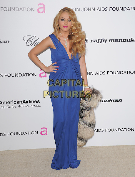 GUEST & PAULINA RUBIO.19th Annual Elton John AIDS Foundation Academy Awards Viewing Party held at The Pacific Design Center, West Hollywood, California, USA..February 27th, 2011.full length blue maxi dress hand on hip.CAP/RKE/DVS.©DVS/RockinExposures/Capital Pictures.