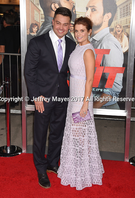 HOLLYWOOD, CA - FEBRUARY 13: Actress JoAnna Garcia (R) and Nick Swisher attend the premiere of Warner Bros. Pictures' 'Fist Fight' at the Regency Village Theatre on February 13, 2017 in Westwood, California.