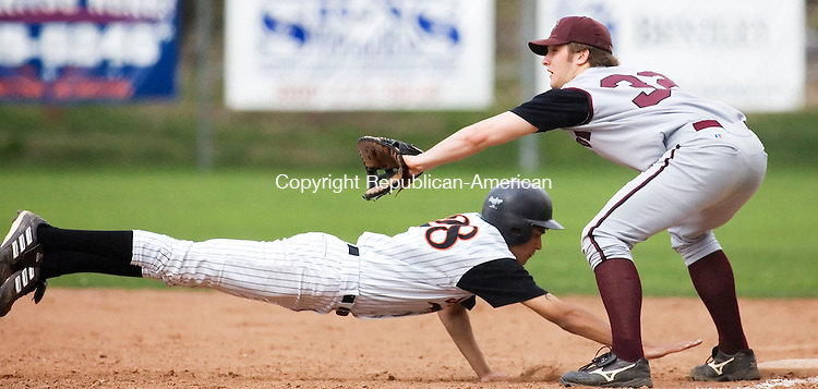 WATERTOWN, CT- 06 MAY 2008- 050608JT05-<br /> Watertown's Marty Tehan dives back to first base as Torrington's Steve Denza waits to catch a throw by pitcher Ryan Jacovich during Tuesday's game at DeLand Field. Watertown won, 4-2.<br /> Josalee Thrift / Republican-American