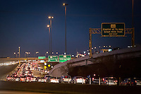 Austin commuters drive home to North Austin, Cedar Park, and Leander from downtown during nighttime rush-hour traffic.