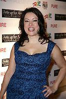 JENNIFER TILLY.The Ante Up for Africa Celebrity Poker Tournament at the Rio Resort Hotel and Casino, Las Vegas, Nevada, USA..July 2nd, 2009.half length blue black dress hand on hip pattern .CAP/ADM/MJT.© MJT/AdMedia/Capital Pictures