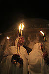 Israel, Jerusalem, Ethiopian Orthodox pilgrims at Deir es Sultan by the dome of St. Helena Chapel at the Church of the Holy Sepulchre on Holy Saturday
