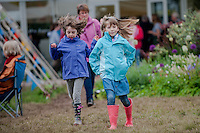 Friday 30 May 2014, Hay on Wye, UK<br /> Pictured: Children walk through the hay festival in wellingtons<br /> Re: The Hay Festival, Hay on Wye, Powys, Wales UK.