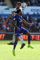 Kyle Naughton of Swansea City battles with Nathaniel Mendez-Laing of Cardiff City during the Sky Bet Championship match between Swansea City and Cardiff City at the Liberty Stadium in Swansea, Wales, UK. Sunday 27 October 2019