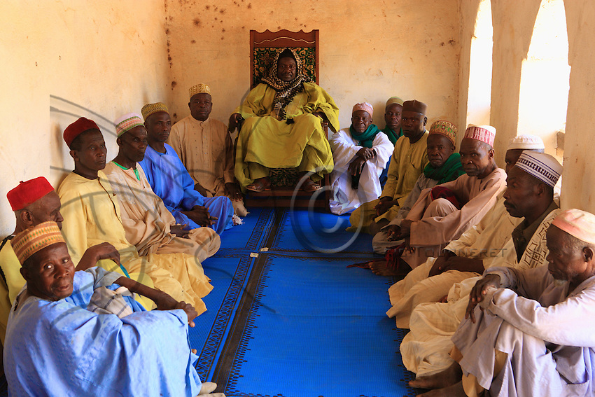 His majesty Aboubakar Mohamadou Mbele, traditional chief of Ngaoundal, surrounded by his council members. The power of the traditional chieftainships is today undergoing a renaissance.