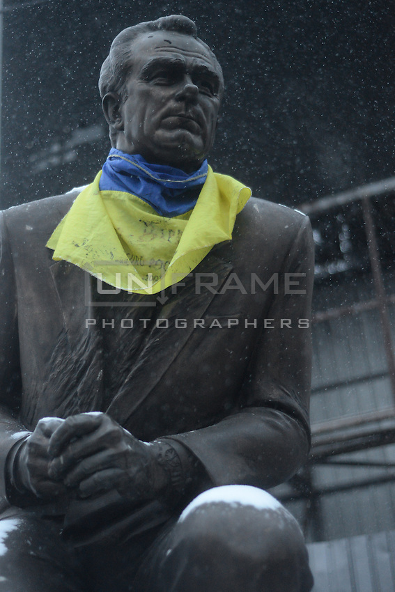 The statue of Valeriy lobanovskiy has been dressed with an Ukrainian flag as a scarf is in the middle of battlefield.  Kiev. Ukraine