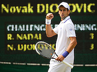 NOVAK DJOKOVIC (SRB) (2) against RAFAEL NADAL (ESP) (1) in the Final of the Gentlemen's SIngles. Novak Djokovic beat Rafael Nadal 6-4 6-1 1-6 6-3..Tennis - Grand Slam - Wimbledon - AELTC - London- Day 13 - Sun July 3rd 2011..© AMN Images, Barry House, 20-22 Worple Road, London, SW19 4DH, UK..+44 208 947 0100.www.amnimages.photoshelter.com.www.advantagemedianetwork.com.