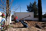 Sergio Pequinino digs a grave in a cemetery in Agua Prieta, Sonora, Mexico, on Wednesday, Jan. 30, 2008.