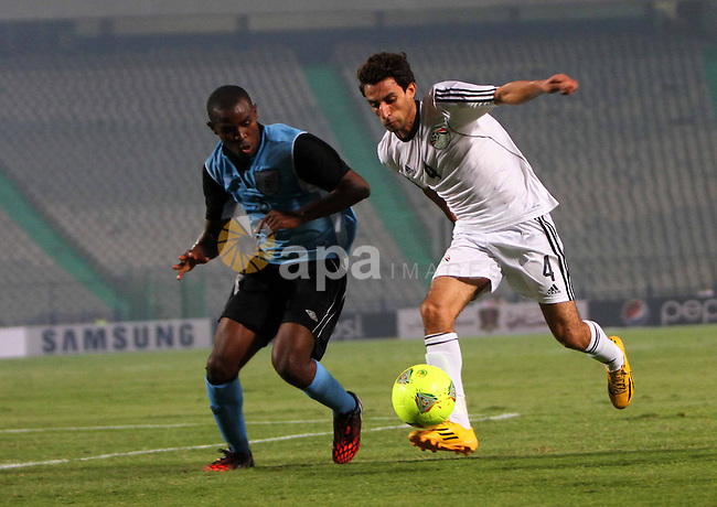 Egyptian players compete against with Botswana players during the qualifying match of 2015 Africa Cup soccer match, in Cairo, capital of Egypt, on Oct. 15, 2014. Egypt won the match with 2-0. Photo by Amr Sayed