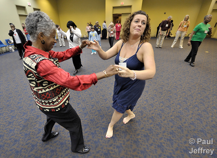 Samantha Byrne (right), a member of United Methodist Women in the West Michigan Annual Conference, dances with another woman in a workshop on salsa dancing at the 2010 Assembly of United Methodist Women in St. Louis, Missouri, Missouri.