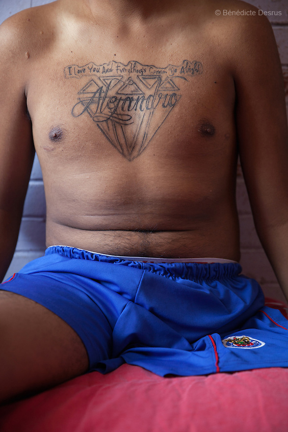 Baruch in his bedroom at his home in the Iztapalapa area of Mexico City, Mexico on July 8, 2014. After the cancer spread, Baruch got a secret tattoo on his chest: &quot;I love you and everything's gonna be alright. Alejandro&rdquo;. It is a message to his mother and grandmother for after he&rsquo;s gone.<br /> Baruch Alejandro Anleu Ramirez, 18, is the captain of Guerreros Aztecas. Two years ago, Baruch had his left leg amputated due to bone cancer. He used to practice as much as his chemotherapy would allow. Expelled from school for missing too many classes during his treatment, he says, &ldquo;Guerreros Aztecas has filled a big hole in my life&rdquo;. Baruch was Guerreros Aztecas&rsquo;s brightest hope to represent Mexico at the Amputee Soccer World Cup. But since the cancer&rsquo;s spread to his lungs, he can no longer play or train with the team. Guerreros Aztecas (&ldquo;Aztec Warriors&rdquo;) is Mexico City&rsquo;s first amputee football team. Founded in July 2013 by five volunteers, they now have 23 players, seven of them have made the national team's shortlist to represent Mexico at this year's Amputee Soccer World Cup in Sinaloa&nbsp;this December.&nbsp;The team trains twice a week for weekend games with other teams. No prostheses are used, so field players missing a lower extremity can only play using crutches. Those missing an upper extremity play as goalkeepers. The teams play six per side with unlimited substitutions. Each half lasts 25 minutes. The causes of the amputations range from accidents to medical interventions &ndash; none of which have stopped the Guerreros Aztecas from continuing to play. The players&rsquo; age, backgrounds and professions cover the full sweep of Mexican society, and they are united by the will to keep their heads held high in a country where discrimination against the disabled remains widespread.&nbsp;(Photo by&nbsp;B&eacute;n&eacute;dicte Desrus)