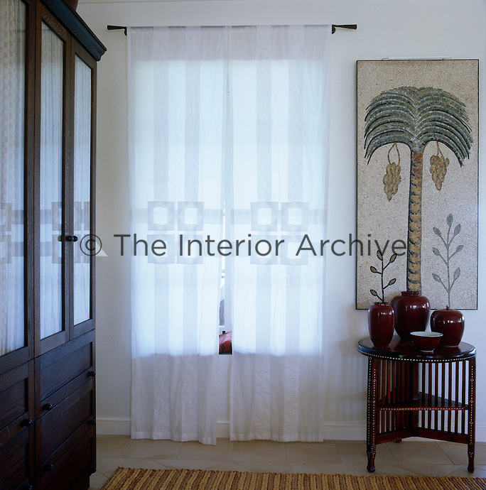 The curtains in this guest bedroom are made of Indian voile and appliqued with a Viennese secession motif