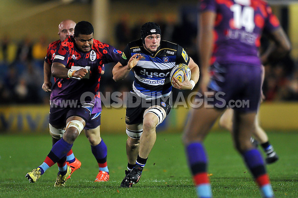 James Catlin of Bath United takes on the Armed Forces defence. Remembrance Rugby match, between Bath United and UK Armed Forces on November 9, 2015 at the Recreation Ground in Bath, England. Photo by: Patrick Khachfe / Onside Images
