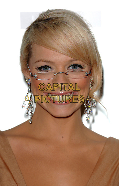 LIZ McCLARNON.The Specsavers Spectacle Wearer Of The Year 2006 - Grand Final at The Waldorf Hilton Hotel, Aldwych, London, UK..October 4th, 2006.Ref: BEL.headshot portrait McLarnon glasses earrings.www.capitalpictures.com.sales@capitalpictures.com.©Tom Belcher/Capital Pictures.