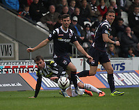 Stuart Kettlewell wins the ball watched by Paul McGowan in the St Mirren v Ross County Scottish Professional Football League Premiership match played at St Mirren Park, Paisley on 3.5.14.
