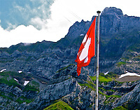 Switzerland flag Swiss Alps blue sky with clouds over the mountains landscape N A Ebden photo