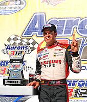 Apr 25, 2009; Talladega, AL, USA; NASCAR Nationwide Series driver David Ragan celebrates after winning the Aarons 312 at the Talladega Superspeedway. Mandatory Credit: Mark J. Rebilas-